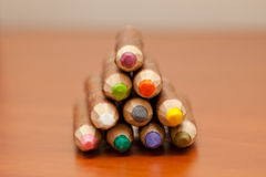 Colored pencils made out of wood bark. Colored pencils handmade from bark pointing into the camera Royalty Free Stock Photos