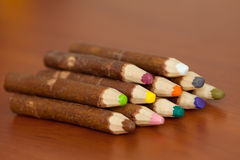Colored pencils made out of wood bark. Colored pencils handmade from bark Stock Photos