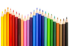 Colored pencils making a wave Stock Photos