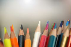 Colored pencils many different opinions educational concept royalty free stock images