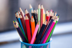 Colored pencils. Many colored pencils in a glass royalty free stock images
