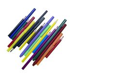 Colored pencils and markers on a white isolated background. Royalty Free Stock Photos