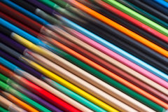 Colored pencils with motion blur. Horizontal top view of a set of colored pencils with motion blur Royalty Free Stock Photography
