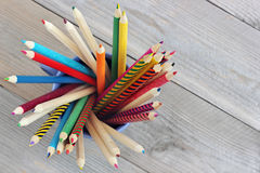 Colored pencils in a mug, top view. Royalty Free Stock Images