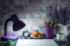 Colored pencils in a mug, vase of lavender flowers, clock, white paper Royalty Free Stock Photo