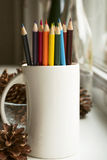 Colored pencils in mug Stock Image