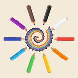 Colored pencils with multicolored spiral. Color festive background. Stock Photo