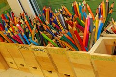 Colored pencils with the names of the children of the school cla Stock Image