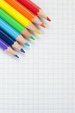 Colored pencils and a notebook Royalty Free Stock Images
