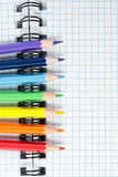 Colored pencils and a notebook Stock Images