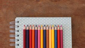 Colored pencils are on notebook Royalty Free Stock Image