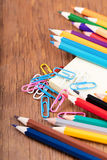 Colored pencils and a notebook Royalty Free Stock Photography