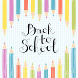 Colored Pencils on notebook sheet with a handwritten inscribed Back to School. Stock Images