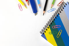 Colored pencils and notebook on the table Stock Photo