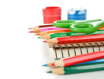 Colored pencils and notebook Royalty Free Stock Photo