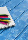 Colored pencils and notebook Royalty Free Stock Photos