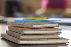 Colored pencils on notebooks with cork caps Stock Photography