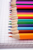 Colored pencils on notepad Royalty Free Stock Photo