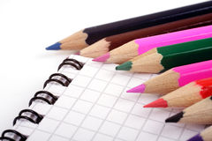 Colored pencils on notepad Royalty Free Stock Photos