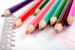 Colored pencils on notepad Stock Photos