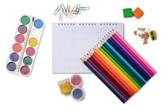 Colored pencils, notepad and other school accessories. Colored pencils, grid notepad, watercolor paints, gouache, erasers, pencil sharpener, paper clips isolated Stock Images