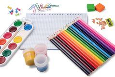 Colored pencils, notepad and school accessories. Colored pencils, grid notepad, watercolor paints, gouache, erasers, pencil sharpener, paper clips  on white Stock Photography