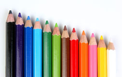 Colored pencils oblique. Colored pencils over a white background oblique array Royalty Free Stock Images