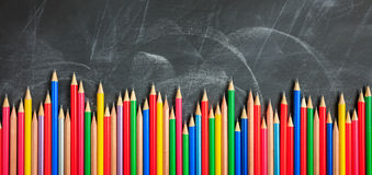 Free Colored Pencils On A Black Board Stock Images - 93830224