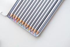 Colored pencils in open box Stock Photo