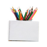 Colored pencils and an open notepad Stock Photo