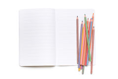 Colored pencils and open workbook Stock Photos