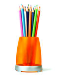 Colored pencils in an orange glass. Stock Image