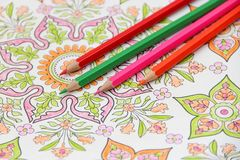 Colored pencils and ornament Royalty Free Stock Photos