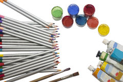 Colored pencils and paint Stock Photography