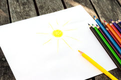 Colored pencils with painted sun Stock Photography