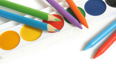 Colored pencils and paints Royalty Free Stock Photos