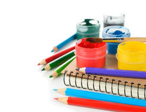 Colored pencils, paints and notebook Royalty Free Stock Images