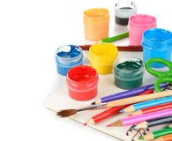 Colored pencils, paints and notebook Royalty Free Stock Photo