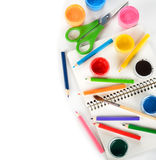 Colored pencils, paints and notebook Stock Images