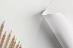 Colored pencils and paper Royalty Free Stock Images