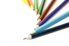 Colored pencils on paper royalty free stock photos