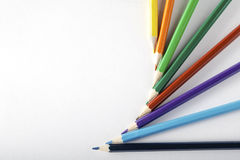 Colored pencils on paper royalty free stock photography