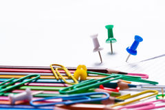 Colored pencils, paper clips and buttons Royalty Free Stock Photos