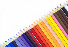 Colored pencils in paper tray on white. Background royalty free stock photo