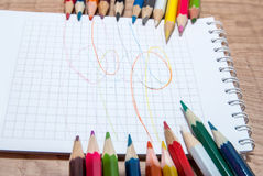 Colored pencils and  paper Royalty Free Stock Image