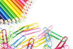 Colored Pencils and Paperclips white copy space. Bright Colored Pencils and Paperclips on a white background with copy space Stock Images