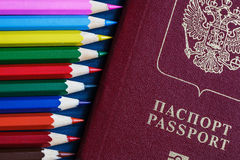Colored pencils and a passport. spoiled documents. Risk of spoiling documents before traveling Stock Photography