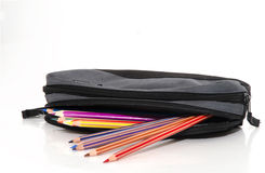 Colored pencils in a pencil case. Isolated on white background Stock Photos