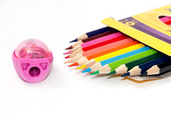 Colored pencils and pencil sharpener Stock Images