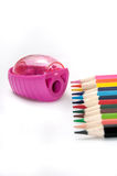 Colored pencils and pencil sharpener Stock Image